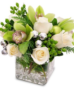 Roses, Orchids & more make up this festive cube design.