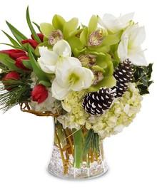 A stunning gathering vase brimming with seasonal blooms!